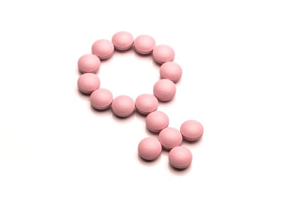 Woman Gender Symbol Made From Pink Round Pills On White Background