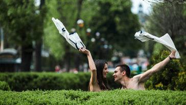 Couple undress in a European city