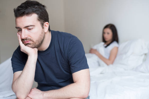 Sad and thoughtful man after arguing with his girlfriend