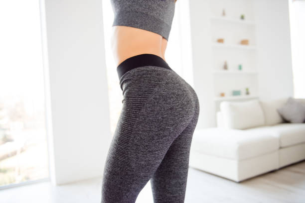 Weightloss wellness eating nutrition vitality concept. Cropped close up view photo of sexual sporty sportive tempting beautiful attractive nice round ass wearing gray tight pants leggings