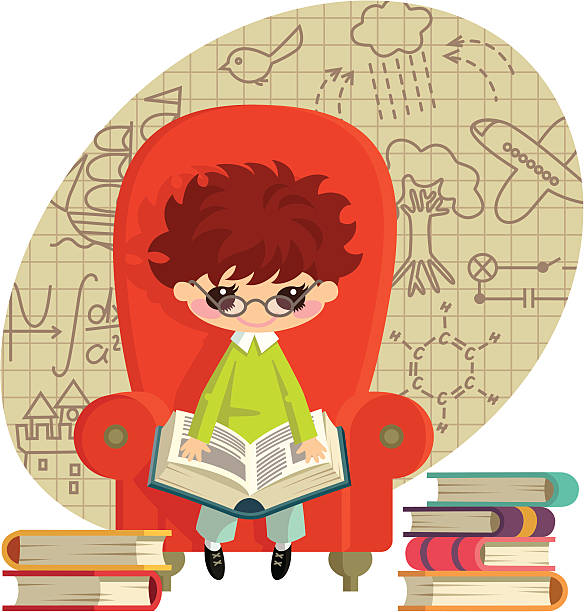 A boy sits in a chair among the many books.