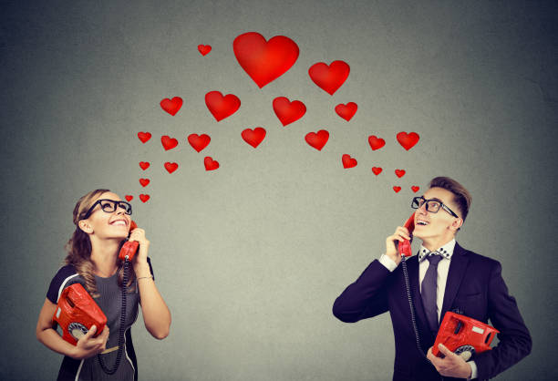 Young couple in love having romantic telephone conversation