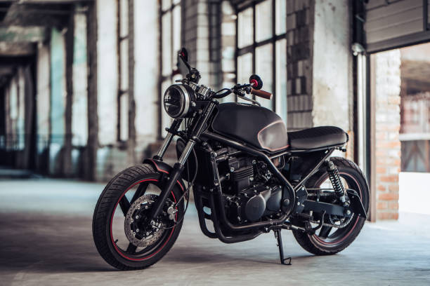 Modern black motorcycle in garage. Cafe racer.